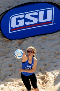 "Alexis Elmurr serves at the GSU Sand Volleyball Complex.  Elmurr's work ethic and hair style have earned her the nickname ""Fraggle."" Photo courtesy of Georgia State Athletics."