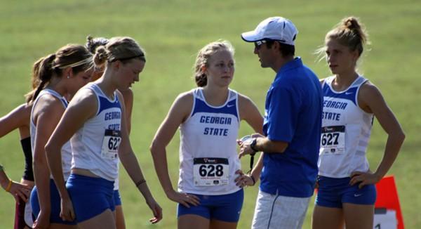 Georgia State Athletics Coach England talking to team.
