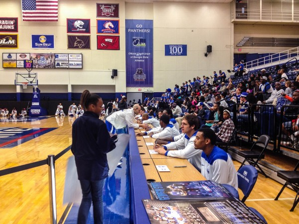ANDRES CRUZ-WELLMANN | THE SIGNAL Men and women basketball players autograph posters for fans on Hoop Day at the Sports Arena last Saturday.