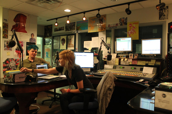 WRAS managers Alayna Fabricus (right) and Alex Jackson (left) discuss the semester's reduced schedule due to GPB's use of the analog station from 5 a.m. to 7 p.m. every day. Photo by Allyson Busch | The Signal