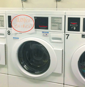 Students put their own signs on laundry room appliances. Photo by: Lauren Booker