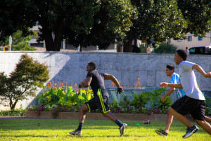 Park goers enjoy a game of football in Hurt Park.  Photo by: Dayne Francis