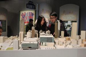 A couple looks over a model of downtown Atlanta's skyscrapers that highlights John Portman's buildings.   Photo Courtesy Atlanta History Center
