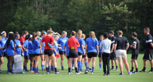 The Georgia State women's soccer team huddle together during a team practice.  Signal Archive