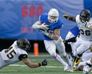 Running Back Kyler Neal tucks the ball during a run against Appalachian State, Oct. 10, 2015.  Photo Submitted by Georgia State Athletics