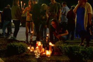 """Atlanta residents gather and light candles in memory of """"Murder Kroger"""", located off Ponce de Leon Avenue. Photo by Christina Maxouris 