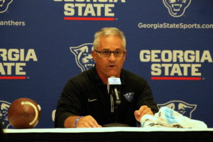 Interim Coach Lappano speaks to the media in a postgame conference.  Photo By Woody Bass | The Signal