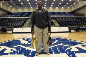 Kesean Henderson poses with her saxophone and her track and field weight inside the GSU Sports Arena. Rhett Lewis | THE SIGNAL