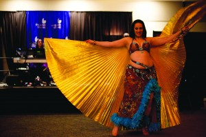 Joshua Yu | The Signal Belly dancers rounded out the entertainment for Moulin Bleu before the DJ entered the stage. The dancer shows dexterity as she moves throughout the ballroom.