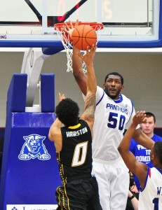 "James Vincent, who also goes by ""Oak,"" uses one of his limbs to alter a shot versus Townson on Feb. 9.  Vincent recieved the nickname due to his tree-like stature and strength.  Photo courtesy of Georgia State Athletics."