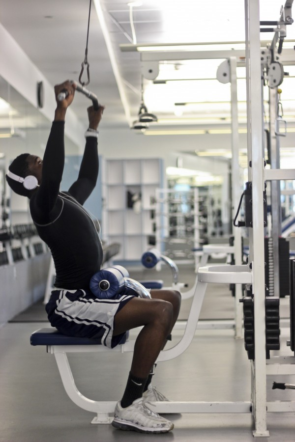 Suraj Jimoh works his upper body at the Recreation Center.