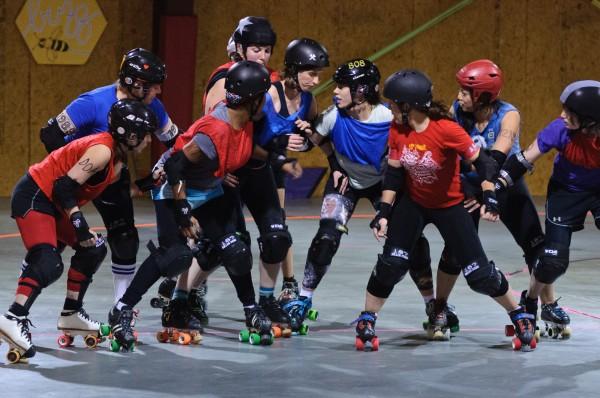 Barbara Tushband (white helmet) blocks against four members of the opposing team.