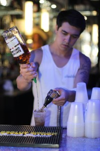 Omar Mustaffa bartends several nights a week at Hole in the Wall.