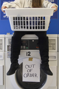 Students must wait to do their laundry since so many washers are out of order. PHOTO BY RUTH PANNILL | THE SIGNAL