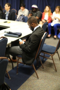 A senator looks on his phone prior to discussions beginning at the SGA's Nov. 5th meeting. Photo by Jason Luong | The Signal
