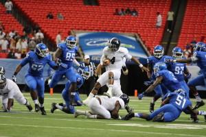 Georgia Southern QB Kevin Ellison scrambles against Georgia State in 2014. Photo By|Brandon Warnock