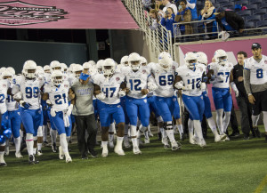 Panthers walk on field before Cure Bowl. Photo By | Jade Johnson