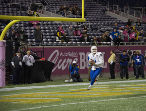 Nick Arbuckle in the end zone doing a drop back pass. Photo by Jade Johnson | The Signal