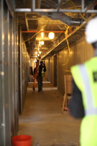Construction workers walk through what will soon be Piedmont Central, Wednesday Jan 20.