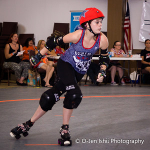 Georgia State student Hale Damage, a jammer, skates on to score a point for her team. Photos Submitted   O-Jen IShii
