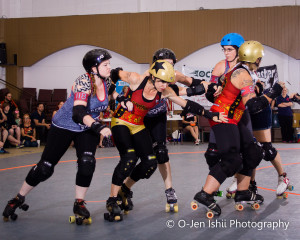 Hate (gold helmet with star), a jammer, tries to get through the blockers. Photos Submitted   O-Jen IShii