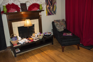 The first room you see as your enter Velvet Lips, featuring a table that includes condoms, lube, and body butters for any guest's taking. Photo by Jade Johnson | The Signal