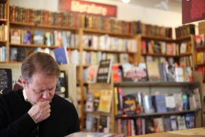 A man reads during his visits to independent bookstore, Acapella Books located in Atlanta neighborhood, Inman Park. Photo by Dayne Francis | The Signal