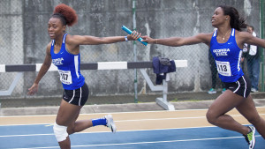 Record breaker Ravin Gilbert grabs baton from teammate Kassandra Pierre during the Florida Relays April 1, 2016.  Photos Submitted by Georgia State Athletics