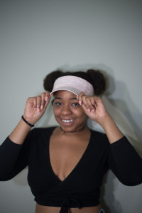 Taylor Taousana, founder of the brand Pussy Power, seeks to impact the world with her feminist clothing; such as caps that come in multiple colors inspired by her brand's color scheme pastel pink, black and white. Photo by Dayne Francis