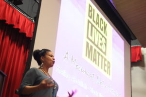 Black Lives Matters activist and leader Melina Abdullah spoke to a room full of people about police brutality and the latest killings of black men at the Auburn Avenue Research Library on African American Culture & History on Sept. 22. Photo by Lahar Samantarai