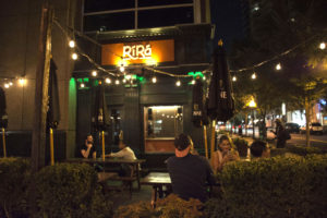 Patrons enjoy drinks in front of Rí Rá Irish Pub located off Crescent Avenue in Midtown Atlanta. Photo by Jade Johnson   The Signal