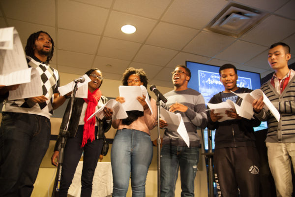"""Georgia State students sing an acapella version of """"This Christmas"""" at the Winter Celebrations Around the World located in Student Center East.   Photo by Hannah Greco 