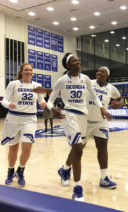 Women's basketball Center Shaq Miller-McCray being embraced by senior Centers Haley Gerrin and Taleah Williams. Photo By Rashad Milligan | the Signal