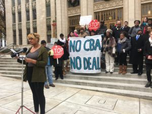USAS member, Aurelia Williams speaks at TFCBC rally held at City Hall, Dec. 19. Photo by Eden Getachew | The Signal