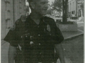 White male police officer